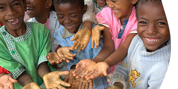 kids smiling showing their hands washed