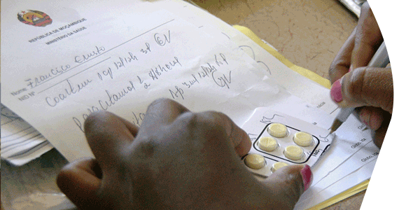 A health provider in Natite, Mozambique, writes up the drug dosage for uncomplicated malaria