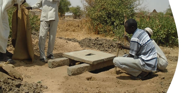 image of people building a latrine